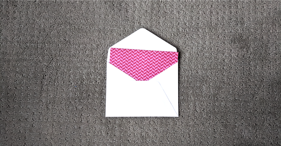 Better Communication with Newsletters. Picture of postcard sticking out of envelope.